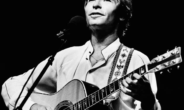 FILE - This July 1983 file photo shows Singer John Denver during an outdoor concert in Boston. The 950-acre property that John Denver bought in the late 1970s as headquarters for his Windstar Foundation is being sold, a move seen by some environmentalists as the unofficial end to the singer's vision to protect some of the land west of Aspen from being overrun by developers. (AP Photo/Keith Jacobson,File)