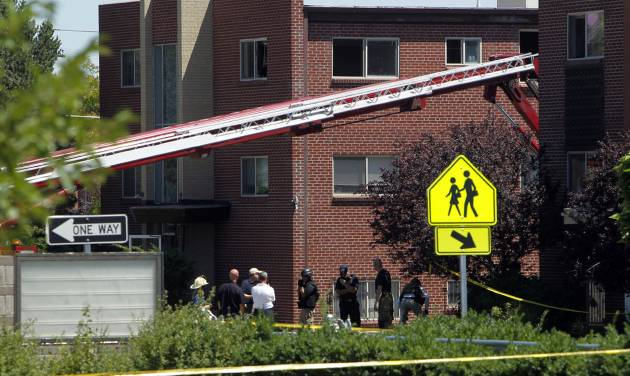 "Firefighters and police gather after an explosion could be heard in front the apartment of shooting suspect James Holmes in Aurora, Colo., Saturday, July 21, 2012. Federal authorities detonated one small explosive and disarmed another inside Holmes' apartment, but several other explosive devices remained, said Aurora police Sgt. Cassidee Carlson. Twelve people were killed and dozens were injured in a shooting attack early Friday at a packed movie theater during a showing of the Batman movie, ""The Dark Knight Rises."" Police have identified Holmes, 24, as the suspected shooter. (AP Photo/Ed Andrieski)"