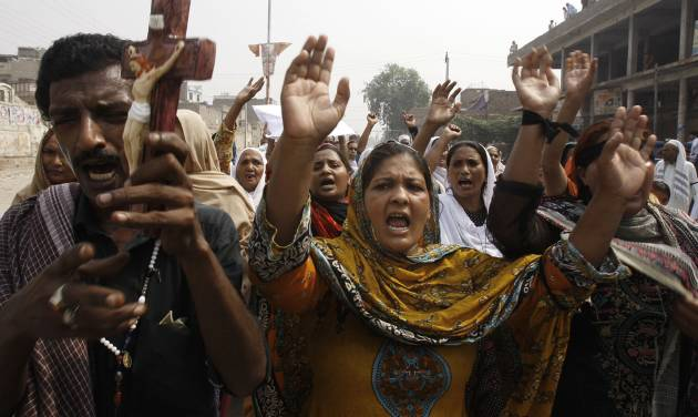 Pakistani Christians chant slogans during a protest to condemn a suicide bombing on a church, in Peshawar,  Pakistan, Monday, Sept. 23, 2013. Angry Pakistani Christians denounced the deadliest attack ever in this country against members of their faith. A pair of suicide bombers blew themselves up amid hundreds of worshippers outside a historic church in northwestern Pakistan. (AP Photo/Mohammad Sajjad)