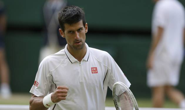 Novak Djokovic of Serbia reacts during his Men's singles match against Tommy Haas of Germany at the All England Lawn Tennis Championships in Wimbledon, London, Monday, July 1, 2013. (AP Photo/Anja Niedringhaus)