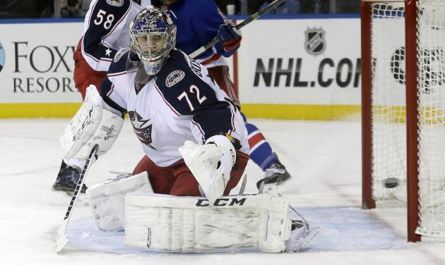 Columbus Blue Jackets goalie Sergei Bobrovsky (72), of Russia, watches a puck shot past the goal during the second period of an NHL hockey game against the New York Rangers Monday, Jan. 6, 2014, in New York.  (AP Photo/Frank Franklin II)