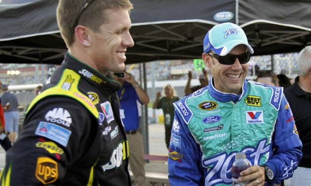 Matt Kenseth, right, laughs with Carl Edwards, left, after winning the pole position for the NASCAR Sprint Cup Series auto race at Daytona International Speedway, Friday, July 6, 2012, in Daytona Beach, Fla. (AP Photo/Terry Renna)