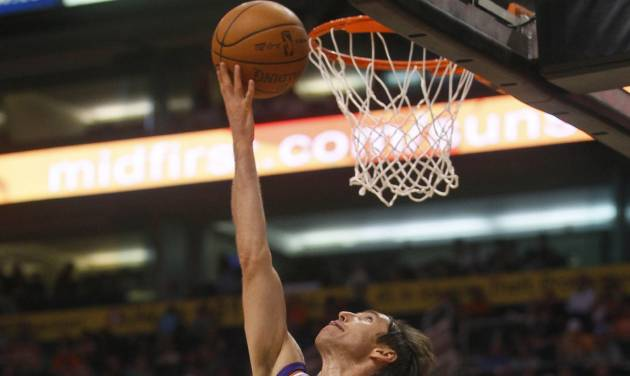 Phoenix Suns' Steve Nash scores against the San Antonio Spurs during the second half of an NBA basketball game, Wednesday, April 25, 2012, in Phoenix. (AP Photo/Matt York)