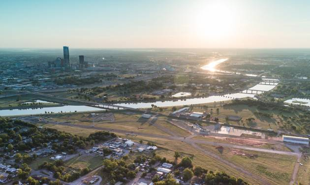 The former Downtown Airpark and most of the property shown to the east will be redeveloped as Wheeler, a new urbanist neighborhood that will tie into the Oklahoma River and downtown. Photo provided    Provided