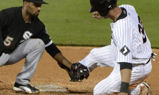 Chicago White Sox's Marcus Semien, left, tags out Birmingham Barons' Kevan Smith during a spring exhibition baseball game in Birmingham, Ala., Friday, March 28, 2014. (AP Photo/ AL.com, Mark Almond) MAGAZINES OUT