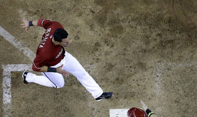 Arizona Diamondbacks' David Peralta, left, cross home plate after Ender Inciarte to score the game winning run on a two RBI double by teammate Paul Goldschmidt against the Miami Marlins during the 10th inning of a baseball game, Wednesday, July 9, 2014, in Phoenix. The Diamondbacks won 4-3 in 10 innings. (AP Photo/Matt York)