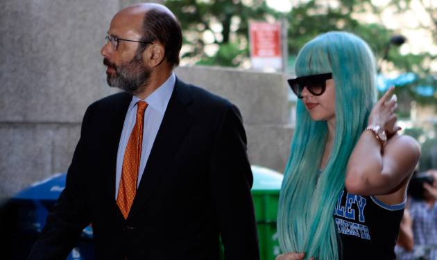 Amanda Bynes, accompanied by attorney Gerald Shargel, arrives for a court appearance in New York, Tuesday, July 9, 2013. The 27-year-old actress is charged with reckless endangerment and attempted tampering with physical evidence.  Bynes was arrested in May after building officials called police to complain she was smoking pot in the lobby. Officers went to her apartment where they say they saw a bong sitting on the kitchen counter. Prosecutors say she tossed the bong out the window in front of the officers.  (AP Photo/Bethan McKernan)