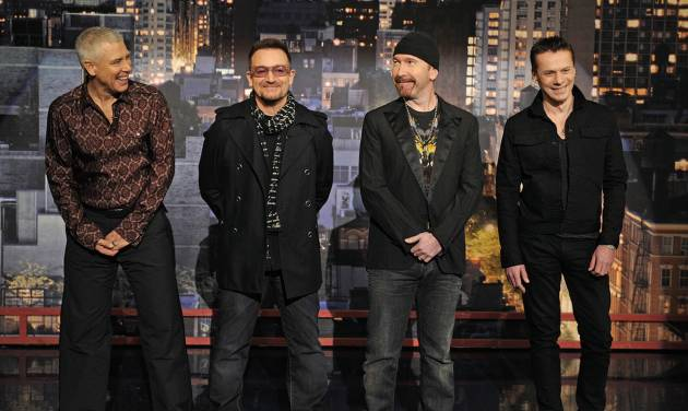 """In this photo released by CBS, members of the band """"U2"""" Adam Clayton, left; Bono, center left; The Edge, center right, and Larry Mullen Jr. present the """"Top Ten Things U2 Has Learned Over the Years"""" on the set of the """"Late Show with David Letterman,"""" Wednesday, March 4, 2009 in New York. (AP Photo/CBS, Jeffrey R. Staab)"""