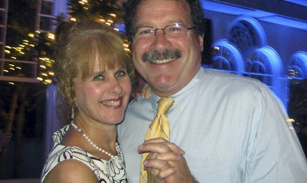 FILE - This undated photo, provided by Bill Sherlach, shows him with his wife, school psychologist Mary Sherlach, who was killed Friday, Dec. 14, 2012, when a gunman opened fire at Sandy Hook Elementary School in Newtown, Conn. Sherlach doesn't know if a lack of mental health care contributed to the shootings that took the life of his wife and 25 others inside the Sandy Hook Elementary school. But Sherlach, whose wife, Mary, was the school's psychologist, is convinced that more and better school mental services can save lives in the future and help other children.  (AP Photo/Courtesy of Bill Sherlach, File)