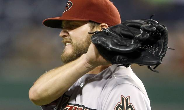 Arizona Diamondbacks starting pitcher Wade Miley snaps his glove after giving up a pinch-hit single to Pittsburgh Pirates' Gregory Polanco in the ninth inning of the baseball game on Tuesday, July 1, 2014, in Pittsburgh. Miley didn't allow a hit until the fifth inning and struck out ten but was taken out after this hit as the Pirates scored three runs in the bottom of the ninth inning to win 3-2. (AP Photo/Keith Srakocic)