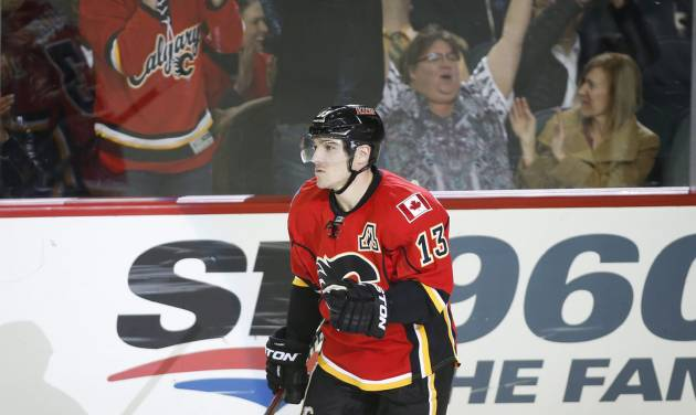 Calgary Flames' Mike Cammalleri reacts to scoring the winning shootout goal during overtime NHL hockey action against the San Jose Sharks in Calgary, Monday, March 24, 2014. The Flames beat the Sharks 2-1 in a shootout. (AP Photo/The Canadian Press, Jeff McIntosh)