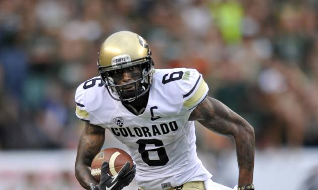 In this Sept. 1, 2013, file photo, Colorado Buffaloes wide receiver Paul Richardson (6) runs against Colorado State during the second half of an NCAA college football game in Denver. Cousins Shaq and Paul Richardson have been squaring off against each other since they were 8 years old tackling each other in Southern California. On Saturday, Oct. 26,  they'll face each other again when Paul's Colorado Buffaloes host Shaq's Arizona Wildcats. (AP Photo/Jack Dempsey, File)