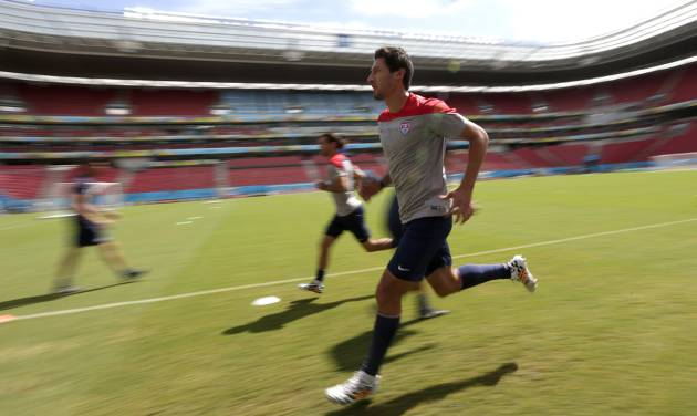 In this photograph taken with a slow shutter, United States' Omar Gonzalez runs during a training session in Recife, Brazil, Wednesday, June 25, 2014. The U.S. will play Germany in group G of the 2014 soccer World Cup on June 26. (AP Photo/Julio Cortez)