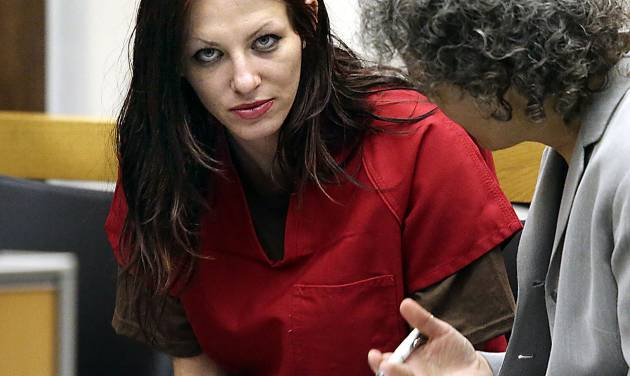 Alix Tichelman, left, of Folsom, Calif., confers with public defender Diane August during her arraignment in Santa Cruz Superior Court Wednesday, July 9, 2014, in Santa Cruz, Calif. Tichelman, an alleged upscale prostitute, is facing manslaughter charges for the November 2013 death of Forrest Hayes, a Google executive. Tichelman, who is also facing drug and prostitution charges, is being held on $1.5 million bail. (AP Photo/Santa Cruz Sentinel, Shmuel Thaler)