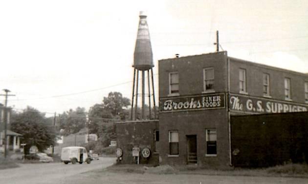 This October 1960 photo provided by Michael Gassmann, shows the iconic giant ketchup bottle water tower outside the old Brooks bottling plant in Collinsville, Ill. The Collinsville water tower is a depiction of Brooks Old Original Rich and Tangy Catsup, which was once produced in the buildings beneath the tower. Now, the sign is for sale. Owner Larry Eckert is asking $500,000 for the 65-year-old, 170-foot (52-meter)-tall landmark and adjacent warehouse. (AP Photo/Courtesy Michael Gassmann)