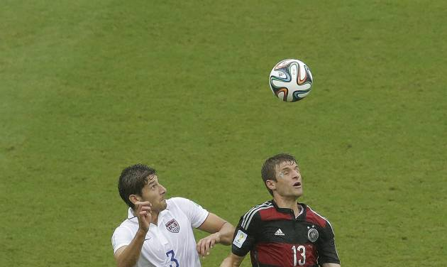 United States' Omar Gonzalez and Germany's Thomas Mueller (13) go up for a ball during the group G World Cup soccer match between the USA and Germany at the Arena Pernambuco in Recife, Brazil, Thursday, June 26, 2014. (AP Photo/Hassan Ammar)