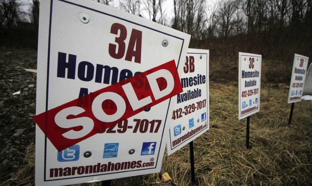 In this Monday, Jan. 13, 2014, photo, a  sold sign is placed on a homesite in the Grace Manor townhouse development in Robinson Township, Pa. Freddie Mac, the mortgage company, releases weekly mortgage rates, on Thursday, Jan. 16, 2014.(AP Photo/Gene J. Puskar)
