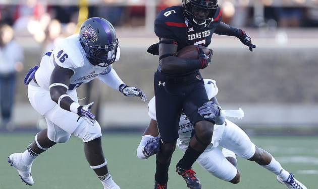 Texas Tech's Devin Lauderdale (6) tries to get past Central Arkansas' Bobby Watkins (7) and D.J. Holland (46) during an NCAA college football game in Lubbock, Texas, Saturday, Aug. 30, 2014. (AP Photo/Lubbock Avalanche-Journal, Tori Eichberger) ALL LOCAL TELEVISION OUT