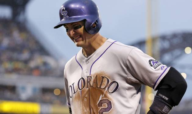 Colorado Rockies shortstop Troy Tulowitzki (2) grimaces as he walks back to the dugout after grounding out to end the fourth inning of a baseball game against the Pittsburgh Pirates in Pittsburgh Saturday, July 19, 2014. Tulowitzki left the game.(AP Photo/Gene J. Puskar)