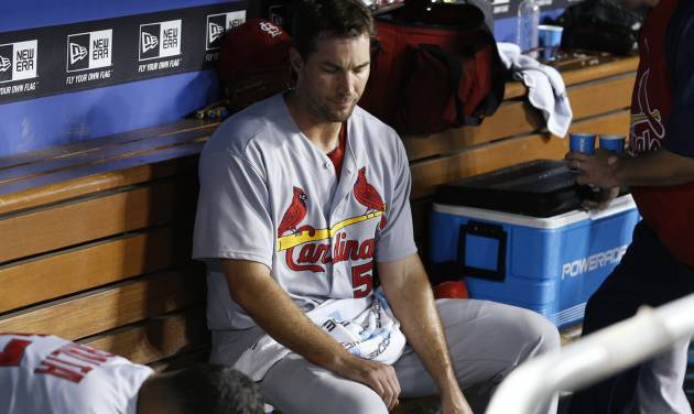 St. Louis Cardinals starting pitcher Adam Wainwright sits in the dugout after the eighth inning of a baseball game, in which he gave up a run on an RBI single by Los Angeles Dodgers' Justin Turner to score Juan Uribe, Thursday, June 26, 2014, in Los Angeles. The Dodgers won 1-0. (AP Photo/Danny Moloshok)