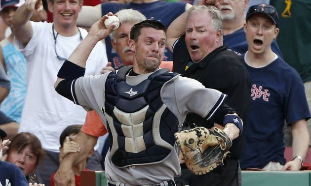 New York Yankees catcher Chris Stewart, center, throws to second base for the double play after fielding a pop foul by Boston Red Sox's Dustin Pedroia in the eighth inning of a baseball game in Boston, Saturday, July 20, 2013. (AP Photo/Michael Dwyer)