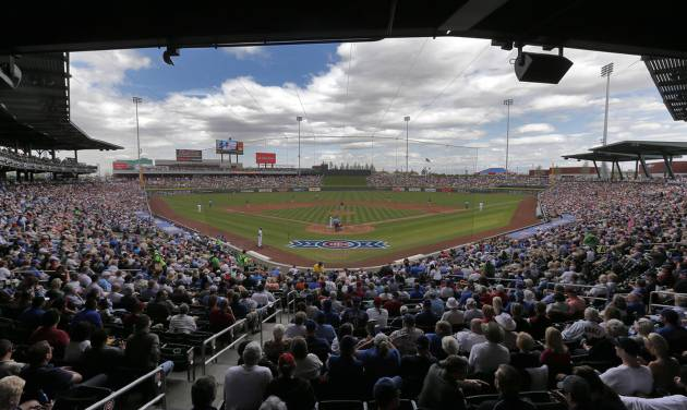 The Arizona Diamondbacks and the Chicago Cubs compete during the third inning of a spring training baseball game on Thursday, Feb. 27, 2014, in Mesa, Ariz. (AP Photo/Matt York)