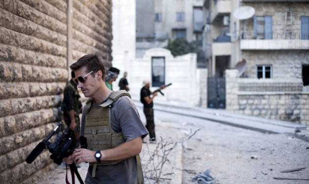 FILE - This September 2012 file photo posted on the website freejamesfoley.org shows journalist James Foley in Aleppo, Syria.In a horrifying act of revenge for U.S. airstrikes in northern Iraq, militants with the Islamic State extremist group have beheaded Foley — and are threatening to kill another hostage, U.S. officials say. (AP Photo/freejamesfoley.org, Manu Brabo, File) NO SALES