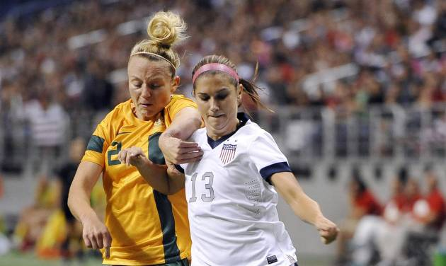 FILE - In this Oct. 20, 2013 file photo, USA forward Alex Morgan, right, tangles with Australia defender Teigen Allen during the first half of an international friendly women's soccer match in San Antonio. Portland's NWSL team is struggling without its star forward as she rehabs from a left ankle injury she sustained while training with the U.S. national team last fall. Morgan is oh-so-close close to her return.(AP Photo/Darren Abate, File)