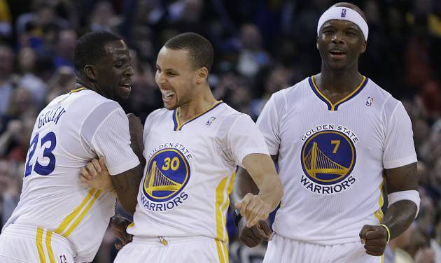 From left, Golden State Warriors' Draymond Green, Stephen Curry and Jermaine O'Neal celebrate during a timeout during the second half of an NBA basketball game against the Brooklyn Nets Saturday, Feb. 22, 2014, in Oakland, Calif. (AP Photo/Ben Margot)