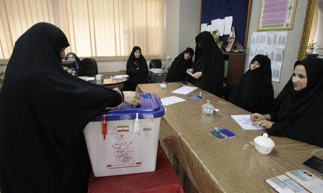An Iranian woman casts her ballot for the parliamentary runoff elections, in a polling station, in Tehran, Iran, Friday, May 4, 2012. The country has begun runoff elections for more than one-fifth of parliamentary seats. Friday's report says 130 hopefuls will compete for 65 seats in 33 constituencies including the capital Tehran with 25 undecided seats. (AP Photo/Vahid Salemi)