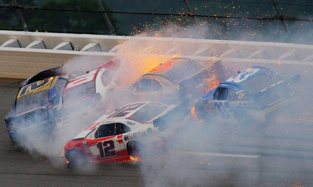 Brian Scott (2) crashes with Johanna Long (70), Trevor Bayne (6), Ty Dilon (33) and Sam Hornish Jr. (12) in Turn 3 during the NASCAR Nationwide Series auto race at the Talladega Superspeedway in Talladega, Ala., Saturday, May 4, 2013. (AP Photo/Greg McWilliams)