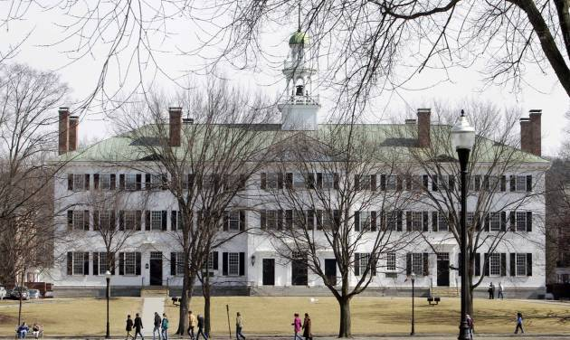 FILE--In this photo taken on March 12, 2012, students walk across the Dartmouth College campus green in Hanover, N.H. High school students hoping to earn college credits through Advanced Placement exams soon will be out of luck at Dartmouth College, which has concluded the tests aren't as rigorous as its own classes. (AP Photo/Jim Cole, File)