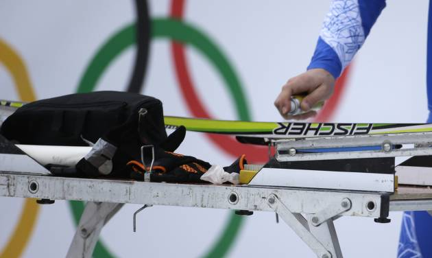 A service technician waxes a ski prior to the cross-country sprint competitions at the 2014 Winter Olympics, Tuesday, Feb. 11, 2014, in Krasnaya Polyana, Russia. (AP Photo/Gregorio Borgia)