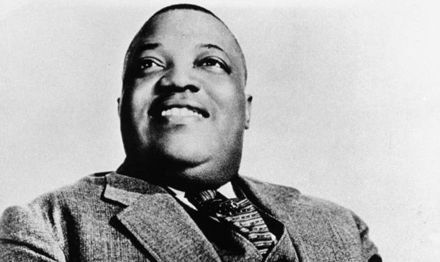Blues vocalist Jimmy Rushing of the Count Basie orchestra is seen in a 1936 publicity photo.  (AP Photo) <strong></strong>