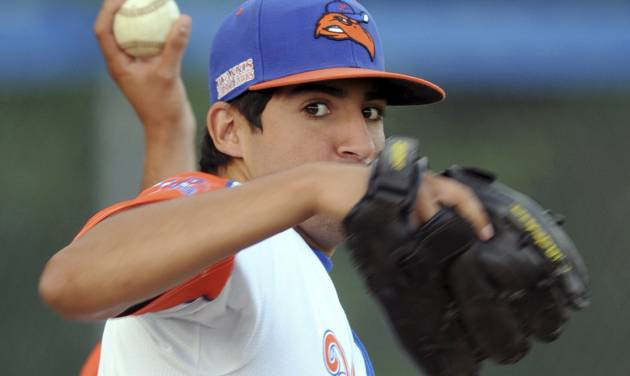 In this Wednesday, July 30, 2014 photo, Hyannis pitcher Ryan Perez, of Hampshire, Ill., pitches with his left hand during warm-ups before a Cape Cod Baseball League game in Hyannis, Mass. The 20-year-old ambidextrous pitcher from tiny Judson University has blossomed into a potential high-round pick for the 2015 draft with his performances this summer in the prestigious Cape Cod League. (AP Photo/Cape Cod Times, Ron Schloerb) MANDATORY CREDIT: CAPE COD TIMES/RON SCHLOERB