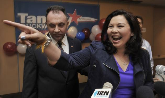 Tammy Duckworth, the Democratic nominee for the Illinois' 8th congressional district of the United States House of Representatives celebrates with husband Bryan Bowlsbey after defeating Rep. Joe Walsh in Elk Grove Village, Ill., Tuesday, Nov. 6, 2012. Duckworth, an Iraq War Veteran, served as a U.S. Army helicopter pilot and suffered severe combat wounds, losing both of her legs. (AP Photo/Paul Beaty)