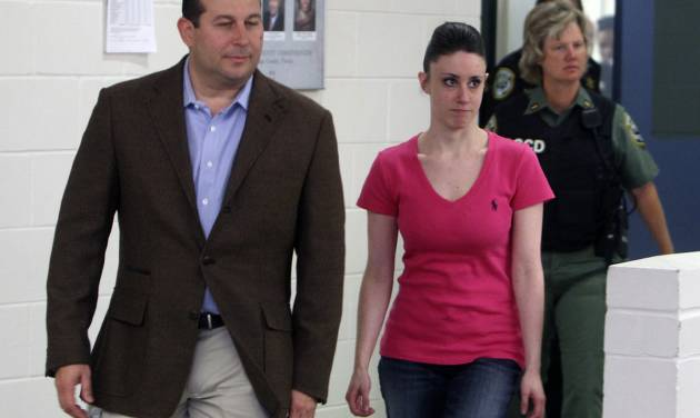 FILE - In this Sunday, July 17, 2011 file photo, Casey Anthony, front right, walks out of the Orange County Jail with her attorney Jose Baez, left, during her release in Orlando, Fla., after being acquitted of murder in the death of her daughter Caylee. The Florida sheriff's office that investigated Caylee Anthony's death confirmed Sunday, Nov. 25, 2012, that it overlooked a computer search for suffocation methods made from the little girl's home on the day she was last seen alive. (AP Photo/Red Huber, Pool, File)