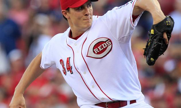 Cincinnati Reds starting pitcher Homer Bailey throws against the Minnesota Twins in the first inning of a baseball game, Friday, June 22, 2012, in Cincinnati. (AP Photo/Al Behrman)