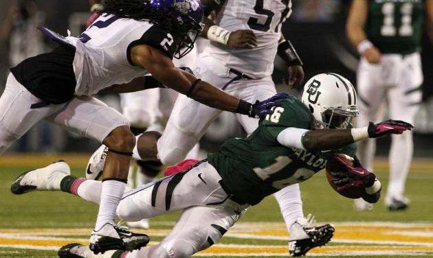 Baylor wide receiver Tevin Reese (16) dives forward for extra yardage after reception as TCU 's Jason Verrett (2) gives chase in the first half of an NCAA college football game Saturday, Oct. 13, 2012, in Waco, Texas. (AP Photo/Tony Gutierrez)