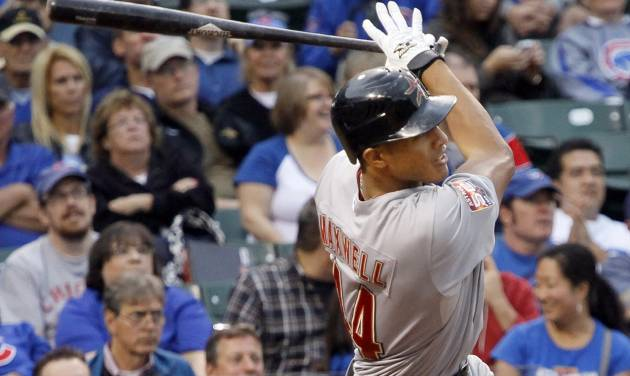 Houston Astros' Justin Maxwell hits a three-run home run off Chicago Cubs relief pitcher Shawn Camp during the eighth inning of a baseball game, Wednesday, Oct. 3 2012, in Chicago. (AP Photo/Charles Rex Arbogast)