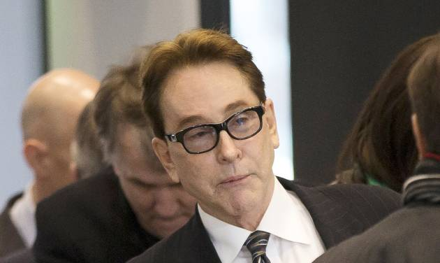 H. Ty Warner, the billionaire who created Beanie Babies, arrives at federal court for sentencing on Tuesday, Jan. 14, 2014, in Chicago. Last year Warner pleaded guilty to one count of tax evasion for hiding $25 million in income in secret Swiss bank accounts. (AP Photo/Andrew A. Nelles)