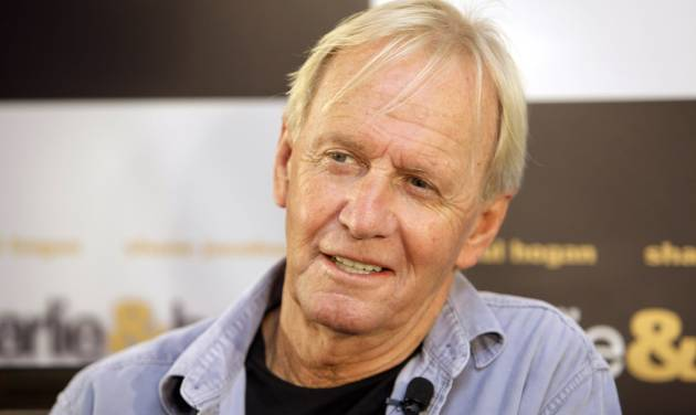 """FILE - In this Oct. 28, 2008 file photo Paul Hogan poses for a photo during a press conference for his movie """"Charlie and Boots"""" at hotel in Sydney. The """"Crocodile Dundee"""" star has resolved his seven-year battle with Australian tax authorities over alleged unpaid taxes dating back to his first international hit movie in the 1980s. Hogan and his friend and producer John Cornell said through their lawyer on Monday, April 30, 2012, the pair had reached a confidential settlement with tax authorities to resolve over 150 million Australian dollars ($156 million) in alleged unpaid taxes and penalties. (AP Photo/Rick Rycroft, File)"""