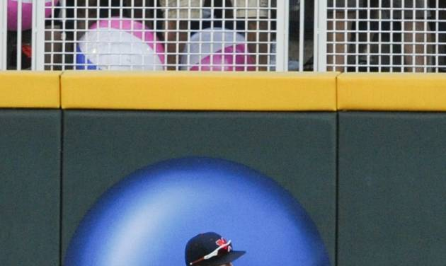 Mississippi right fielder J.B. Woodman bumps into the wall after catching a fly ball hit by TCU's Derek Odell in the fourth inning of an NCAA baseball College World Series elimination game in Omaha, Neb., Thursday, June 19, 2014. (AP Photo/Eric Francis)