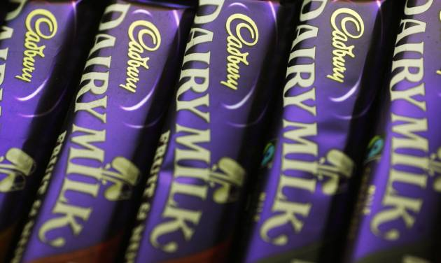 FILE - This Jan. 19, 2010 file photo shows bars of Cadbury chocolate, a Mondelez brand, at a stall in central London. Mondelez reports quarterly financial results on Wednesday, Aug. 6, 2014. (AP Photo/Sang Tan, File)