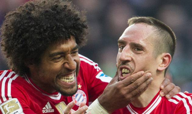 Bayern's Dante of Brazil, left, and Bayern's Franck Ribery of France celebrate after teammate Arjen Robben scored his side's 4th goal during the German Bundesliga soccer match between VfL Wolfsburg and Bayern Munich in Wolfsburg, Germany, Saturday, March 8, 2014. (AP Photo/Gero Breloer)
