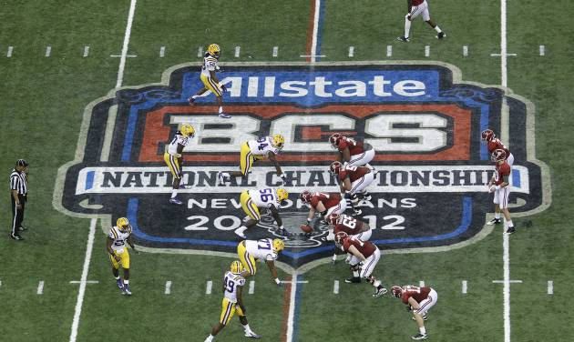 """FILE - In this Jan. 9, 2012, file photo, Alabama, right, prepares to snap the ball against LSU during the first half of the BCS National Championship college football game in New Orleans. College football has taken a big step toward having a final four. BCS Executive Director Bill Hancock said, Thursday, April, 26, 2012, that conference commissioners will present a """"small number"""" of options for a four-team playoff to their leagues. (AP Photo/Bill Haber, File)"""