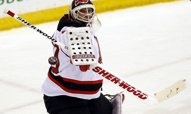 New Jersey Devils goalie Martin Brodeur deflects a shot during a scrimmage against the Albany Devils, the team's AHL farm team, Wednesday, Jan. 16, 2013, in Newark, N.J. (AP Photo/Julio Cortez)