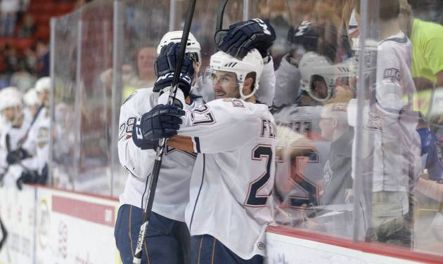 Oklahoma City's Martin Marincin, left, and Taylor Fedun celebrate after Fedun scored in the second period of Thursday's game against Texas.  PHOTO BY STEVEN CHRISTY, OKLAHOMA CITY BARONS