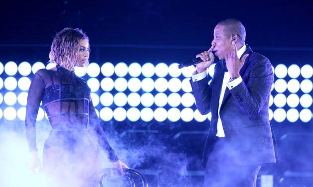 "FILE - This Jan. 26, 2014 file photo shows Beyonce, left, and Jay Z performing ""Drunk in Love"" at the 56th annual Grammy Awards in Los Angeles. Beyoncé and Jay Z lead in nominations for the BET Awards. The network announced Wednesday that the performers are both nominated for five awards, along with Drake. Pharrell and rising performer August Alsina have four nominations. The BET Awards will air live on June 29 from the Nokia Theatre L.A. Live. (Photo by Matt Sayles/Invision/AP, File)"