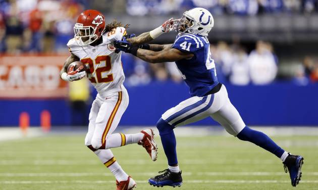 FILE - In this Jan. 4, 2014, file photo, Kansas City Chiefs wide receiver Dexter McCluster (22) runs against Indianapolis Colts strong safety Antoine Bethea (41) during an NFL wild-card playoff football game in Indianapolis. Titans kicked off the first day of NFL free agency Tuesday, March 11, by agreeing to terms with Chiefs' McCluster, said a person familiar with the situation. (AP Photo/Michael Conroy, File)